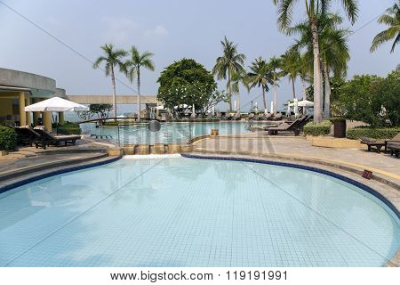 THAILAND, PATTAYA, MARCH, 26, 2015 -  Modern swimming-pool  with clear turquoise water in Pattaya, Thailand