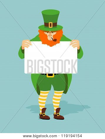 Leprechaun And Billboard. Red Dwarf And  White Sheet Of Paper. Mythical Irish Character In Green Clo