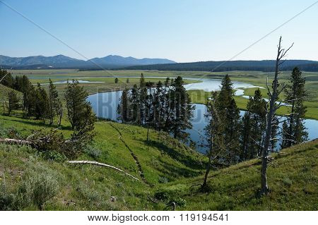 View over the course of the Yellowstone River from a hillside.