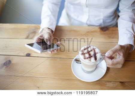 Hand Woman Using Phone In Cafe