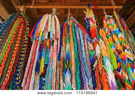 Closeup of traditional thousand Origami cranes, long prayer strings hanging at Hokkeji Temple in Takayama, Gifu, Japan