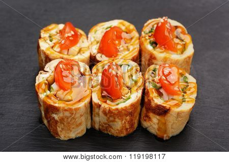 Fusion Rolls With Omelette And Tomatoes On Black Palte