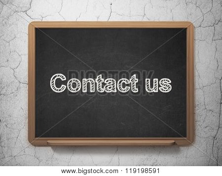 Business concept: Contact us on chalkboard background