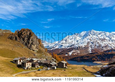 Village Of Grevasalvas And The Alps In Golden Autumn