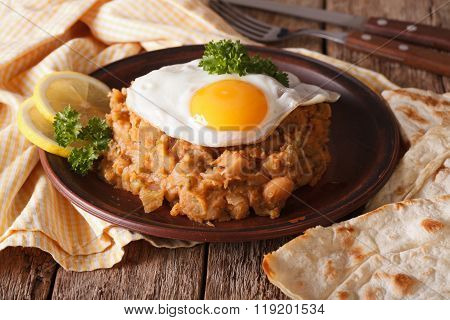 Arabic Ful Medames With Fried Eggs Close-up On The Table. Horizontal