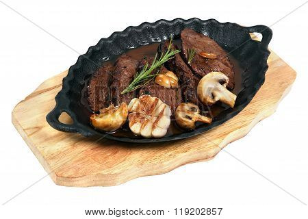 Flank Steak Baked In An Oval Cast Iron Plate
