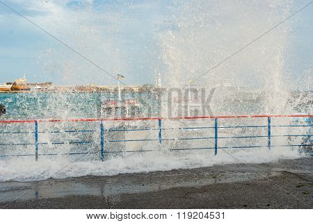 Heavy wave broken on a pleasure boats anchorage
