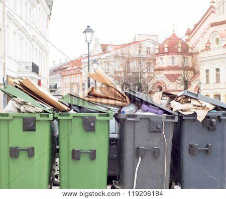 Plastic bins full of trash