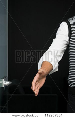 Office worker offering handshake
