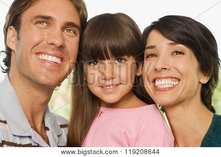Happy girl and parents