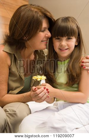 Girl and grandmother with flower