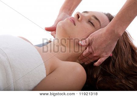 Massage therapist massaging woman's neck