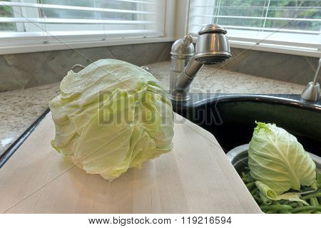 Head Of Cabbage On Chopping Board