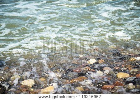 Stony Beach And Ocean Water