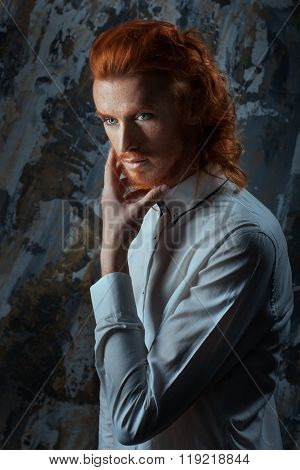 Portrait Of A Man With Fiery Curls On His Head.