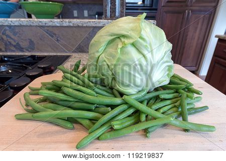 Cabbage And String Beans On Chopping Board