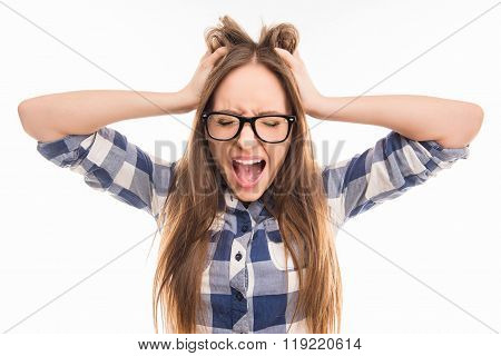 Portrait Of Crazy Cute Girl In Glasses Shouting And Holding Hair