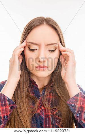 Sad Young  Woman  Suffering From Headache And Touching Her Temple