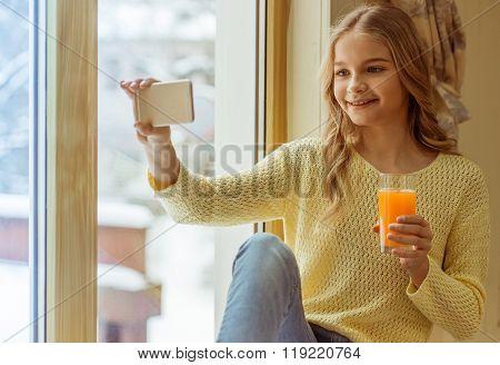 Teenage Girl With Gadget