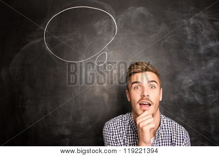 Portrait Of Young Man Thinking About Bright Idea