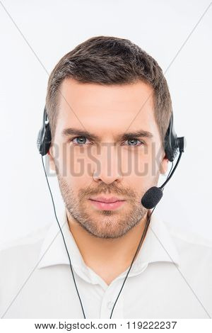 A Close-up Photo Of Serious Young Agent Of Call Centre