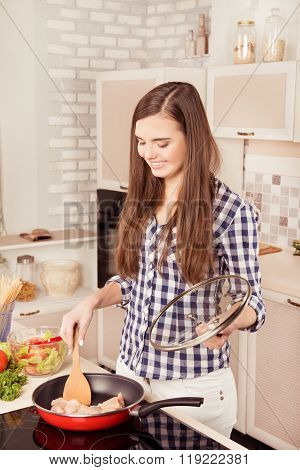 Cheerful Happy Woman Frying Chicken Meat For Dinner