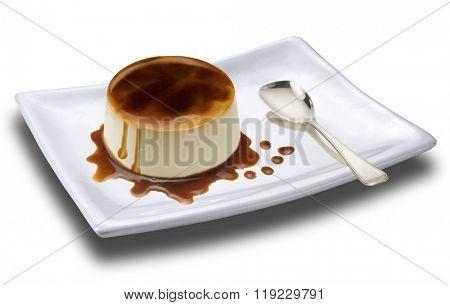 cream caramel dessert on white plate