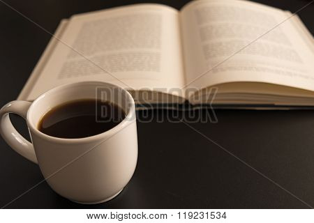 Open Book With A Cup Of Coffee At The Black Table