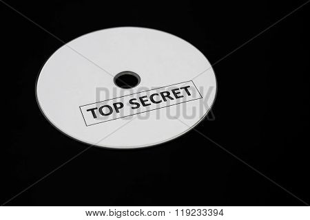 Compact Disc With Label Of Top Secret On A Black Background
