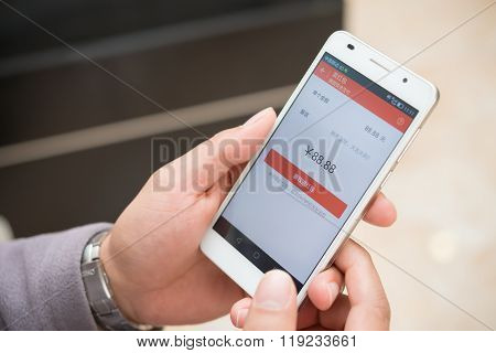Zhongshan,china-feb 21,2016:young Man Preparing Red Pocket On Mobile On Wechat For Chinese New Year
