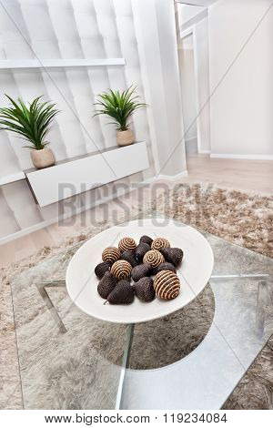 Fruits Shaped Bamboo Or Reed Decoration And Brown Thread Spin Or Yarn On A White Plate