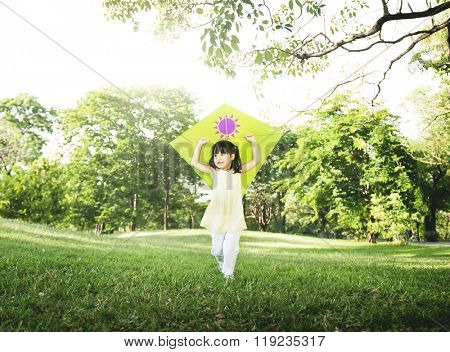 Little Girl Flying Kite Playing Cheerful Activity Concept