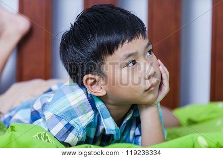 Sad Child Inside Bedroom. Problem Families Concept.