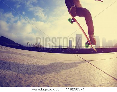 closeup of one young skateboarder skateboarding on city