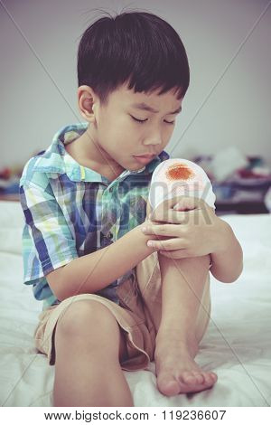 Child Injured. Wound On The Child's Knee With Bandage. Vintage Style.