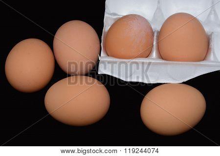 Half dozen of eggs in carton