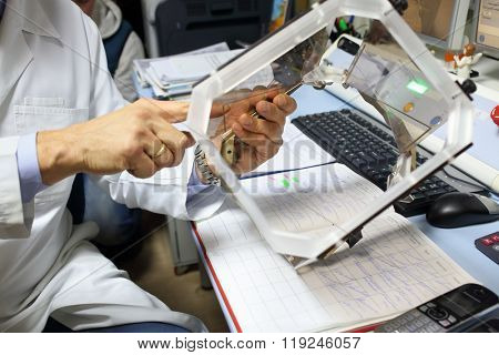 MOSCOW - MAY 19, 2015: Stereotactic frame in hands of doctor in the department of radiology and radiosurgery at the Burdenko Institute of Neurosurgery in Moscow