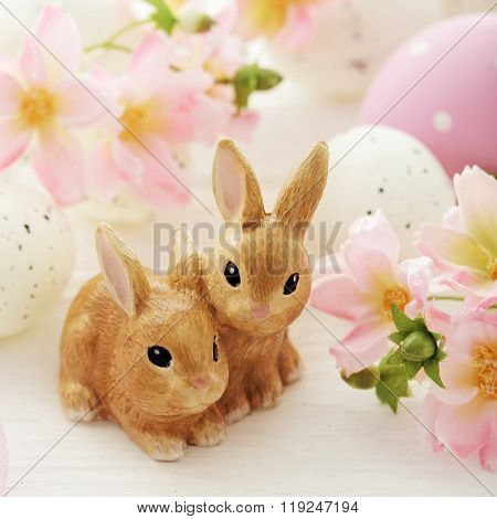 colorful easter eggs, rabbits and spring flowers