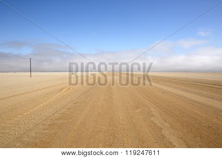 Deserted gravel road leading up the Skeleton Coast, Namibia.