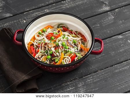 Vegetable Stir Fry And Rice Noodles In An Enamel Bowl On A Dark Wooden Background. Healthy Vegetaria