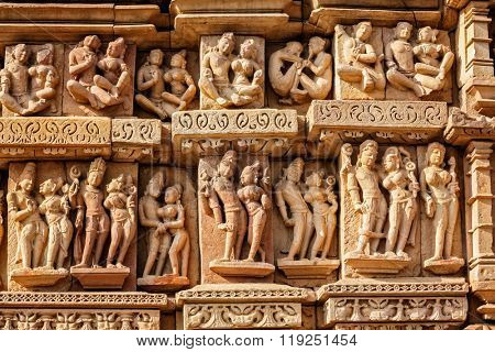 Stone carving bas relief sculptures on Adinath Jain Temple, famous indian tourist site Khajuraho, Madhya Pradesh, India
