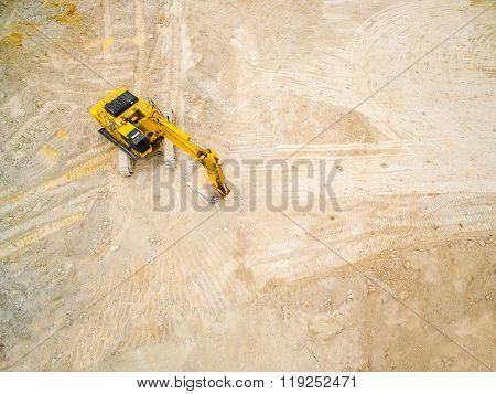 Aerial view of a excavator in the mine. Use drones to inspect of your business.