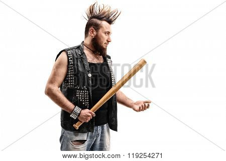 Violent punk rocker holding a baseball bat and threatening someone isolated on white background