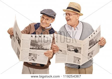 Two senior gentlemen reading the news together and smiling isolated on white background