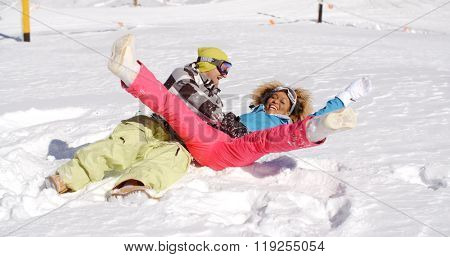 Young couple enjoying a frolic in the snow