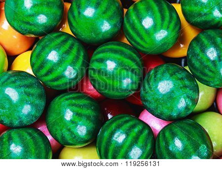 colored chewing gum in the form of a water-melon background