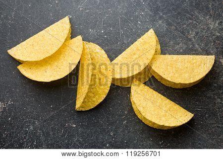 crispy taco shells on old kitchen table