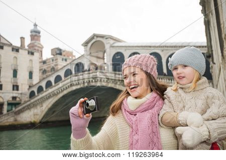 Happy Mother And Daughter Taking Photos Near Rialto Bridge