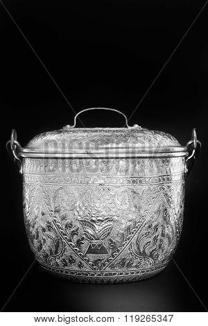 Antique silver Thai pot on black background