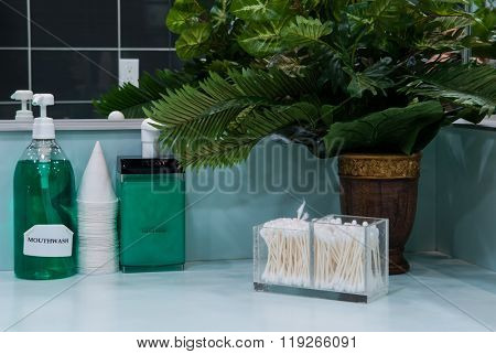 Hand soap and mouthwash on bathroom shelf